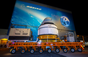 Nov. 21, 2019 - The Boeing CST-100 Starliner spacecraft rolls out from the company's Commercial Crew and Cargo Processing Facility at NASA's Kennedy Space Center in Florida. Credits: Boeing