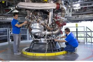 RS-25 development engine 0525 in the A-1 test stand at NASA's Stennis Space Center in Mississippi undergoes inspection by Aerojet Rocketdyne technicians (August 2015).