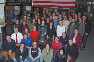 Members of Aerojet Rocketdyne's Orion team in Redmond, WA, with one of the auxiliary engines for the Orion Artemis 2 European Service Module.