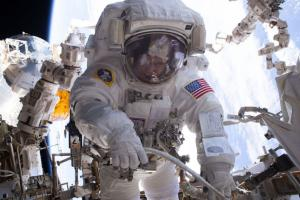 2017-Astronaut Peggy Whitson during a spacewalk installed three new adapter plates & hooked up electrical connections for three of six new lithium-ion batteries on the International Space Station. Credit: NASA